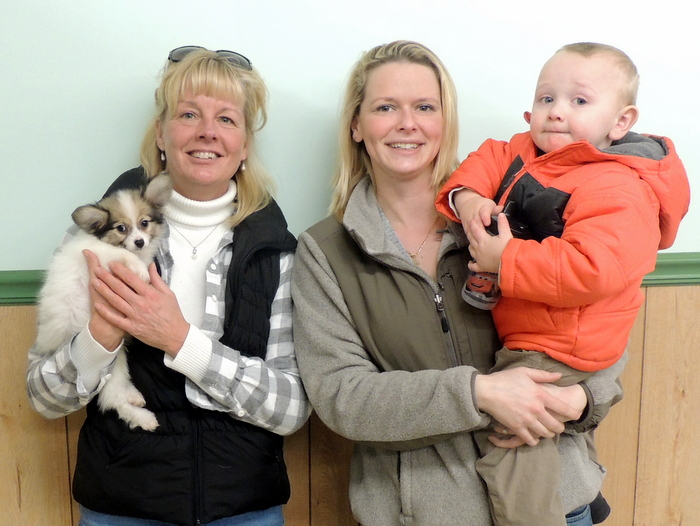 Sandy, Courtney and Riley picking up one of Tiziano and Little Bits little Papillon Puppies, Gus